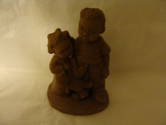 Small Black Girl and Boy Holding Bear